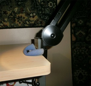 Foam windscreen above and below clamp to transmit less bumping from scissor-mount mic stand
